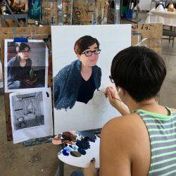 Woman painting self portrait
